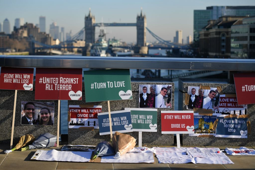 Banners and pictures are placed on London Bridge in memory of the victims. (Photo by DANIEL LEAL-OLIVAS/AFP via Getty Images)