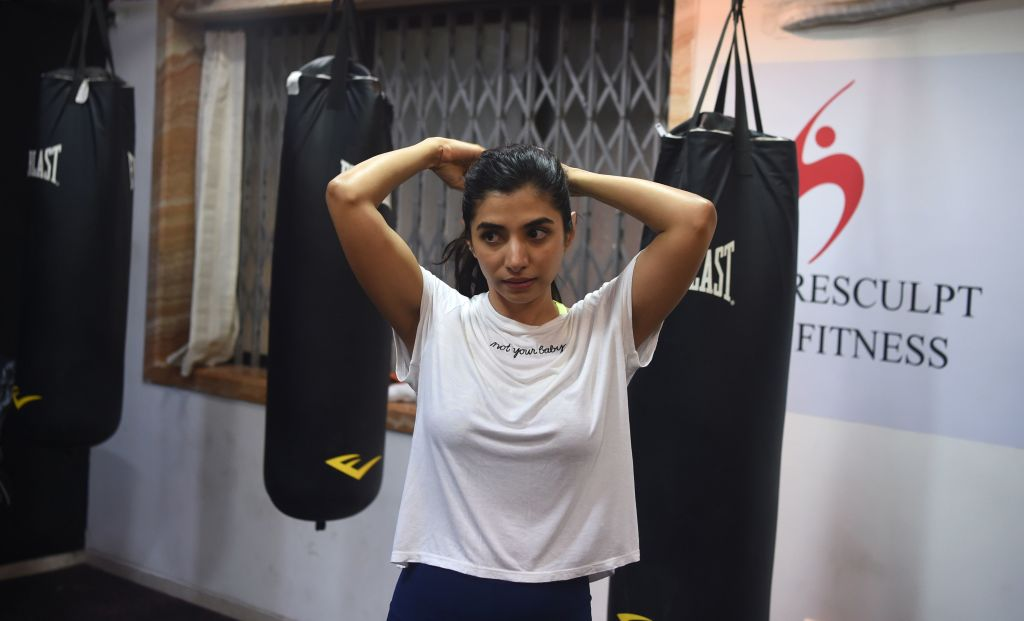 "Malhaar Rathod attends a kickboxing session at a gym in Mumbai. - Rathod's previous experience with what is euphemistically known as Bollywood's ""casting couch"" culture underlines the challenges facing anyone seeking to break into India's massive, insiders-only film industry. (Photo by PUNIT PARANJPE / AFP)"