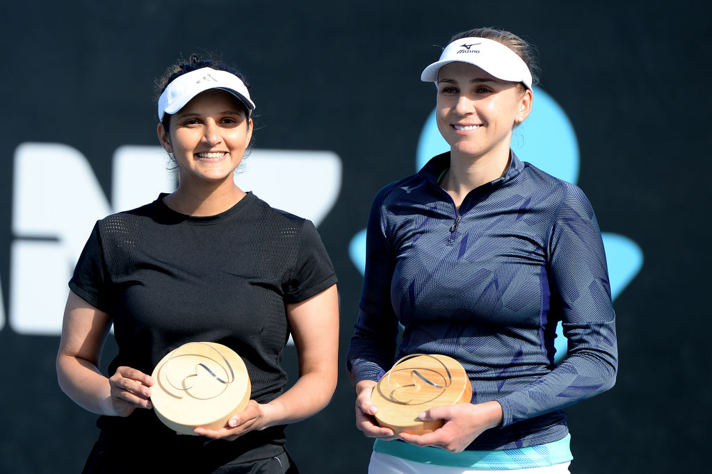 Nadiia Kichenok of Ukraine and Sania Mirza of India celebrate after winning their final doubles match against Zhang Shuai and Shuai Peng of Chinaon day eight of the 2020 Hobart International at Domain Tennis Centre on January 18, 2020 in Hobart, Australia. (Photo by Steve Bell/Getty Images)