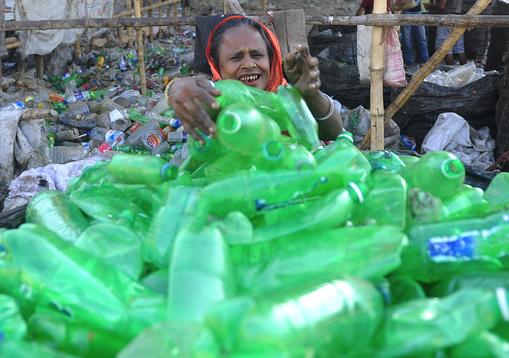 A Bangladeshi woman works in a plastic bottle recycling factory besides the river Buriganga in Dhaka on February 27, 2012. Bangladesh is one of the poorest nations on the planet with 40 percent of its 144 million people living on less than one US dollar per day. AFP PHOTO/Munir uz ZAMAN