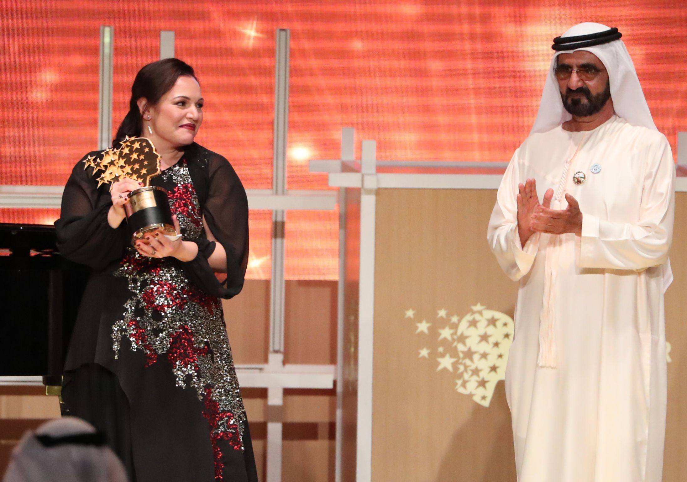 Andria Zafirakou (pictured with Sheikh Mohammed bin Rashid al-Maktoum, vice-president and prime minister of the UAE) won the Global Teacher Prize and $1million prize money in 2018 (Photo credit: KARIM SAHIB/AFP via Getty Images)