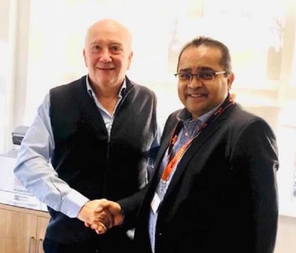 Nick Wells, CEO Whistl and Atul Bhakta (R), CEO One World Express Group.
