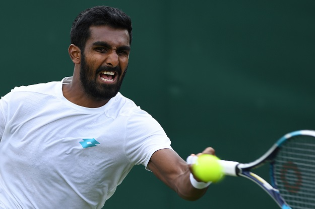 Gunneswaran started off well enough, leading 30-0 on Ito's serve twice in the first set and again in the second. The world number 123, however, could not convert those chances into games on the board, leading to another early Grand Slam exit (Photo: GLYN KIRK/AFP via Getty Images).