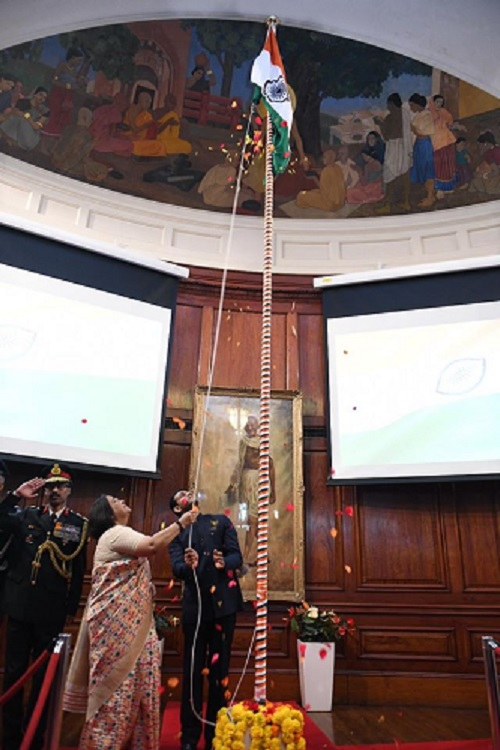 Indian High Commissioner to the UK, Ruchi Ghanashyam unfurls the Indian Tricolour.