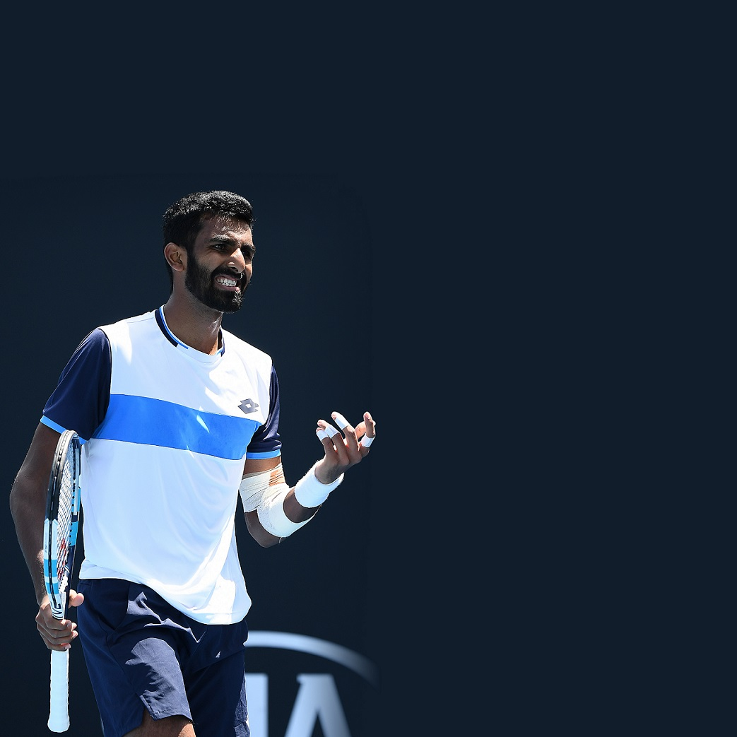 Prajnesh Gunneswaran of India reacts during his Men's Singles first round match against Tatsuma Ito of Japan on day two of the 2020 Australian Open at Melbourne Park on January 21, 2020 in Melbourne, Australia. (Photo by Quinn Rooney/Getty Images)