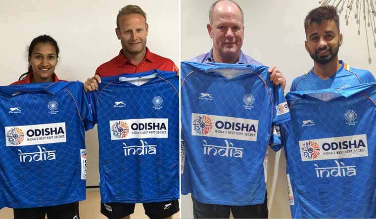 India women's hockey team captain Rani Rampal (left) with coach Sjoerd Marijne and men's captain Manpreet Singh (third from left) with coach Graham Reid holding up the jerseys given for auction | via Twitter