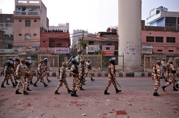 Paramilitary troops patrol in a riot affected area after clashes erupted between people demonstrating for and against a new citizenship law in New Delhi, India, February 25, 2020 (Photo: REUTERS/Danish Siddiqui).