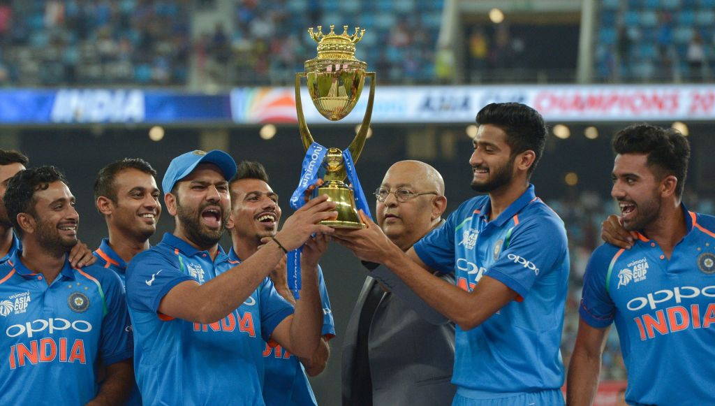 FILE PHOTO: Indian Cricket team captain Rohit Sharma (3L) and team celebrates after won during the final one day international (ODI) Asia Cup cricket match between Bangladesh and India at the Dubai International Cricket Stadium in Dubai on September 28, 2018. (Photo by ISHARA S. KODIKARA / AFP via Getty Images)