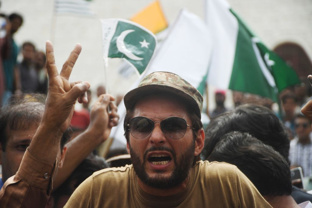FILE PHOTO: Pakistani cricketer Shahid Afridi take part in an anti-India protest rally in Karachi. (Photo ASIF HASSAN/AFP via Getty Images)