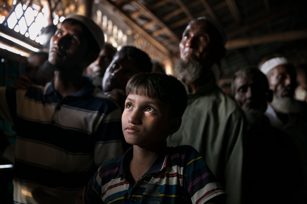 Rohingya refugees watch ICJ proceedings at a restaurant in a refugee camp on December 12, 2019 in Cox's Bazar, Bangladesh. (Photo by Allison Joyce/Getty Images)