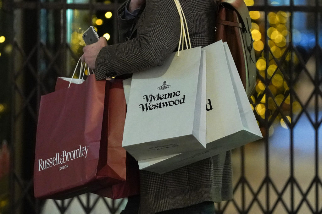FILE PHOTO: A shopper with multiple luxury goods bags in London, England. (Photo by Peter Summers/Getty Images)