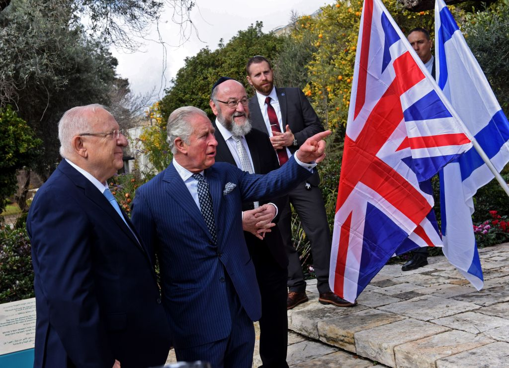 Britain's Prince Charles (2nd L) and Israeli President Reuven Rivlin (L) talk after planting a tree outside the presidential residence in Jerusalem, ahead of a meeting on the sidelines of the Fifth World Holocaust Forum held in Israel. (Photo by DEBBIE HILL/POOL/AFP via Getty Images)