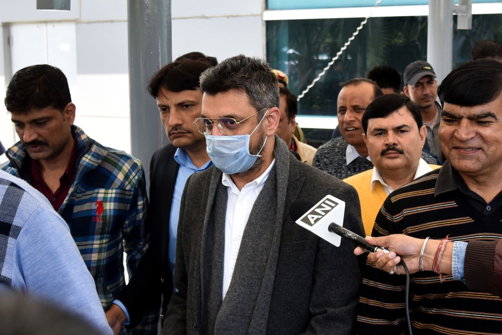 Sanjeev Chawla (C), who was allegedly involved in a match-fixing racket that was busted by the Delhi Police in 2000, is escorted out of the Indra Gandhi International Airport upon his extradition from London, in New Delhi. (Photo by -/AFP via Getty Images)