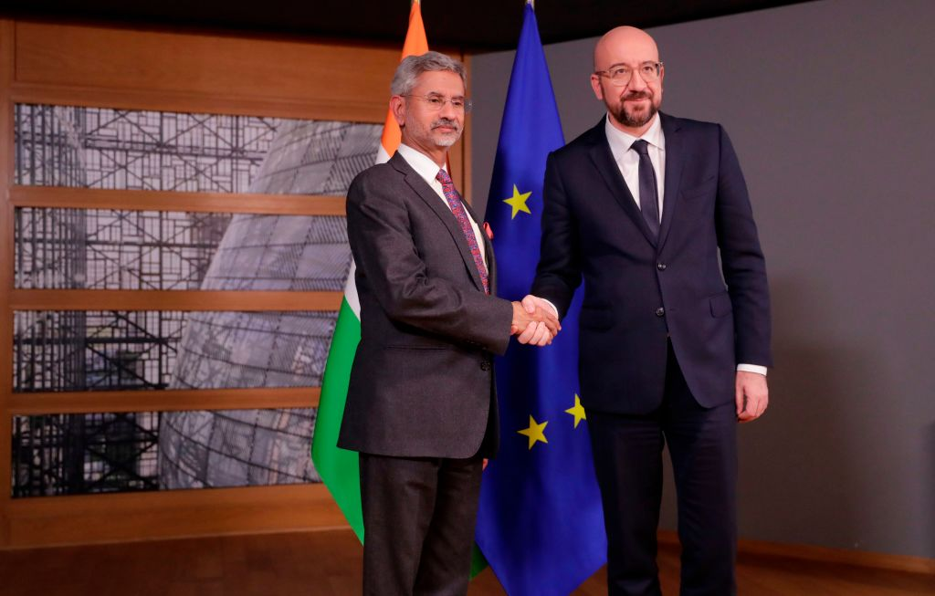 Indian foreign minister Subrahmanyam Jaishankar (L) is welcomed by European Council president Charles Michel prior to a meeting at the European Council headquarters in Brussels, on February 17, 2020. (Photo by Olivier HOSLET / POOL / AFP)