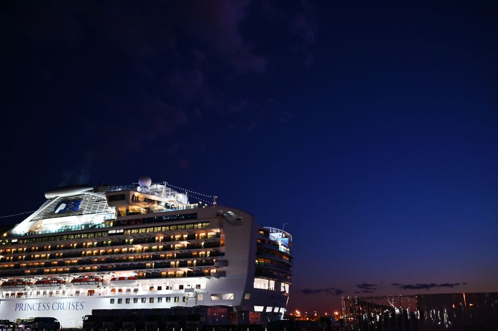 The Diamond Princess cruise ship is pictured at dusk at the Daikoku Pier Cruise Terminal in Yokohama port. (Photo by CHARLY TRIBALLEAU/AFP via Getty Images)