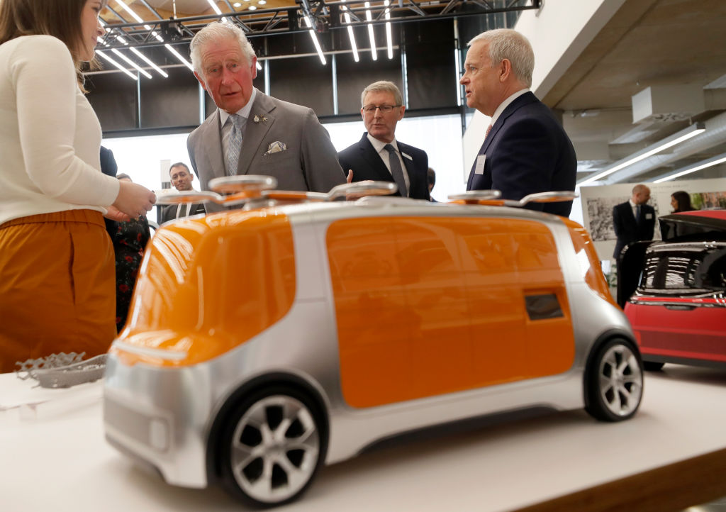 Prince Charles checks out a concept car model at the Tata JLR National Automotive Innovation Centre. (Photo: Getty Images)