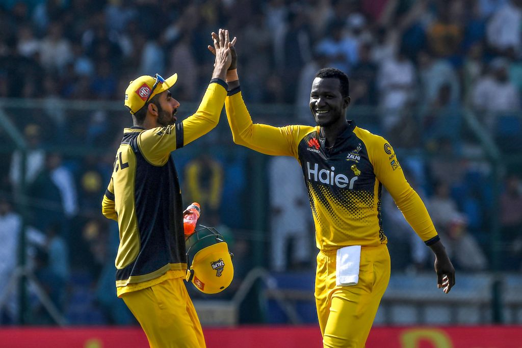 Peshawar Zalmi's team captain Daren Sammy (R) celebrates with teammates after taking the wicket of Sarfaraz Ahmed during the Pakistan Super League (PSL) T20 cricket match between Peshawar Zalmi and Quetta Gladiators in the National Cricket Stadium in Karachi on February 22, 2020. (Photo by ASIF HASSAN/AFP via Getty Images)
