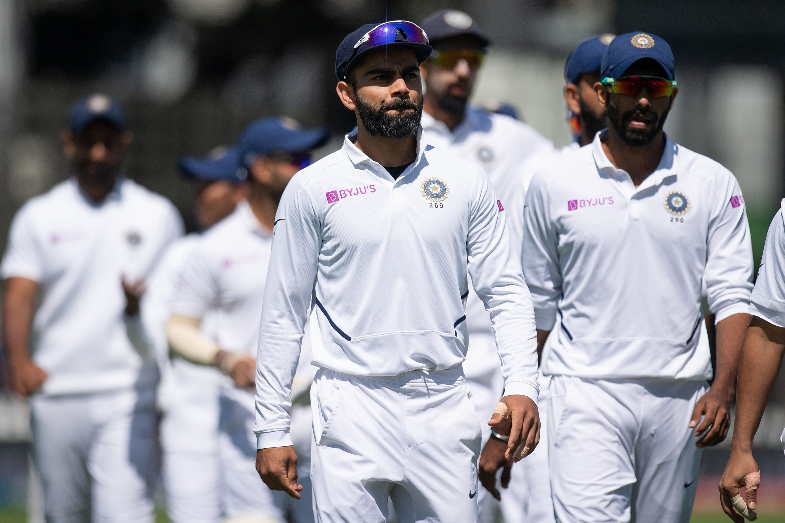 India's captain Virat Kohli (C) walks from the field with his team after losing the match to New Zealand during day four of the first Test cricket match between New Zealand and India at the Basin Reserve in Wellington on February 24, 2020. (Photo by Marty MELVILLE / AFP) (Photo by MARTY MELVILLE/AFP via Getty Images)