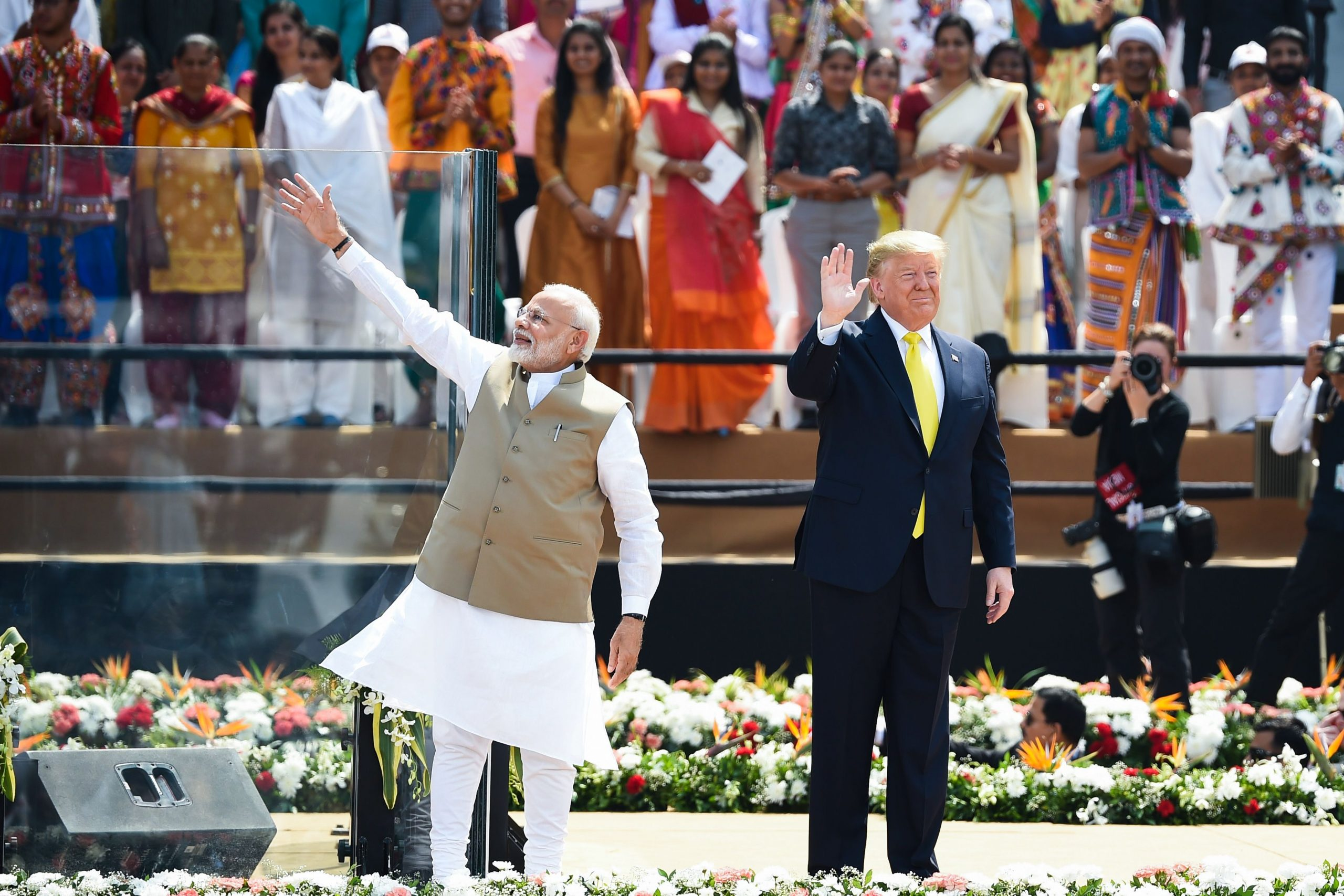 US president Donald Trump (R) and India's prime minister Narendra Modi wave at the crowd during 'Namaste Trump' rally at Sardar Patel Stadium in Motera, on the outskirts of Ahmedabad, on February 24, 2020. (Photo by Money SHARMA / AFP) (Photo by MONEY SHARMA/AFP via Getty Images)