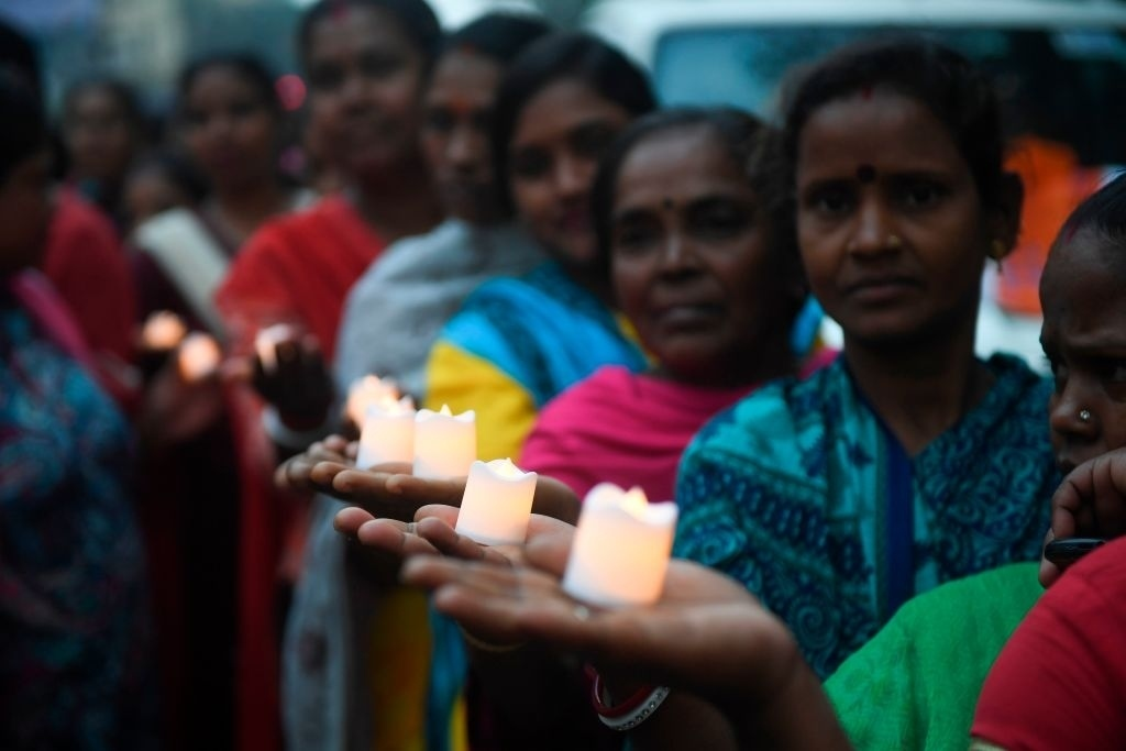 Activists of the All India Trinamool Congress hold electric candles during a vigil to condemn the recent sectarian violence in New Delhi. (Photo: DIBYANGSHU SARKAR/AFP via Getty Images)