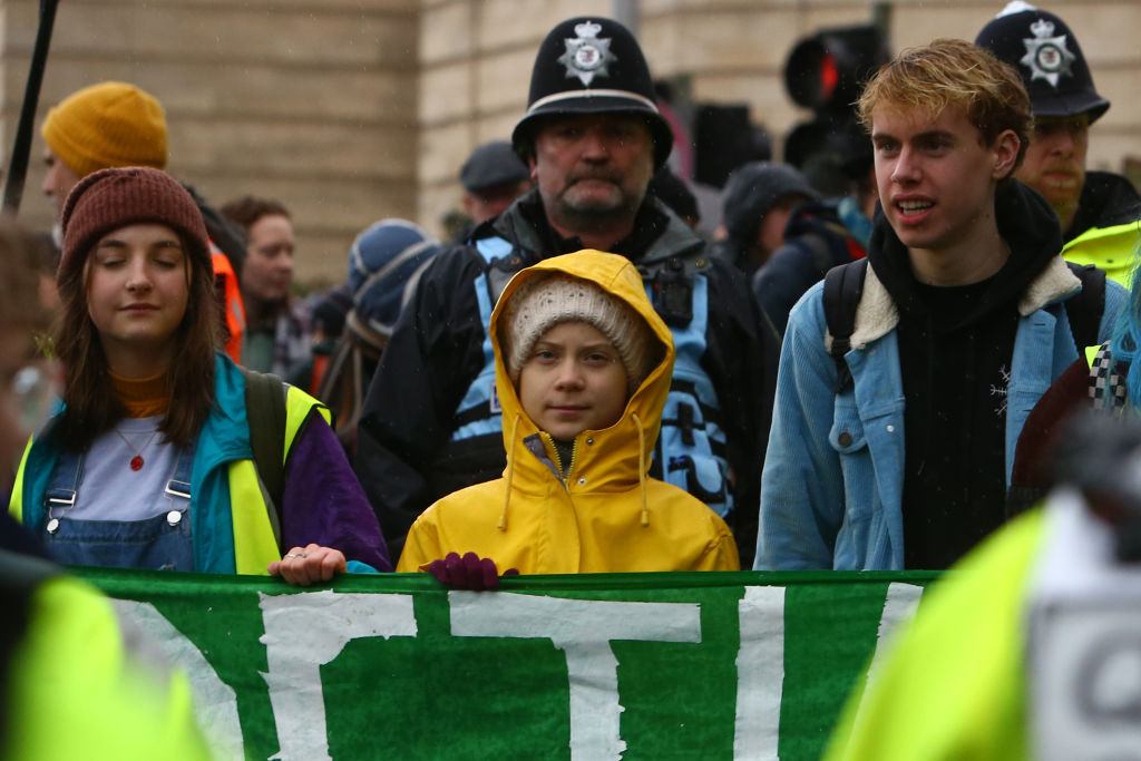 "Swedish climate activist Greta Thunberg (C) takes part in a ""Youth Strike 4 Climate"" protest in Bristol, south west England on February 28, 2020. (Photo by GEOFF CADDICK/AFP via Getty Images)"