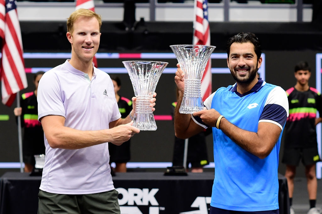 Dominic Inglot of Great Britain and Aisam-Ul-Haq Qureshi of Pakistan with their championship trophies, after winning the New York Open men's doubles final match against Steve Johnson and Reilly Opelka of the US. (Photo: Steven Ryan/Getty Images)