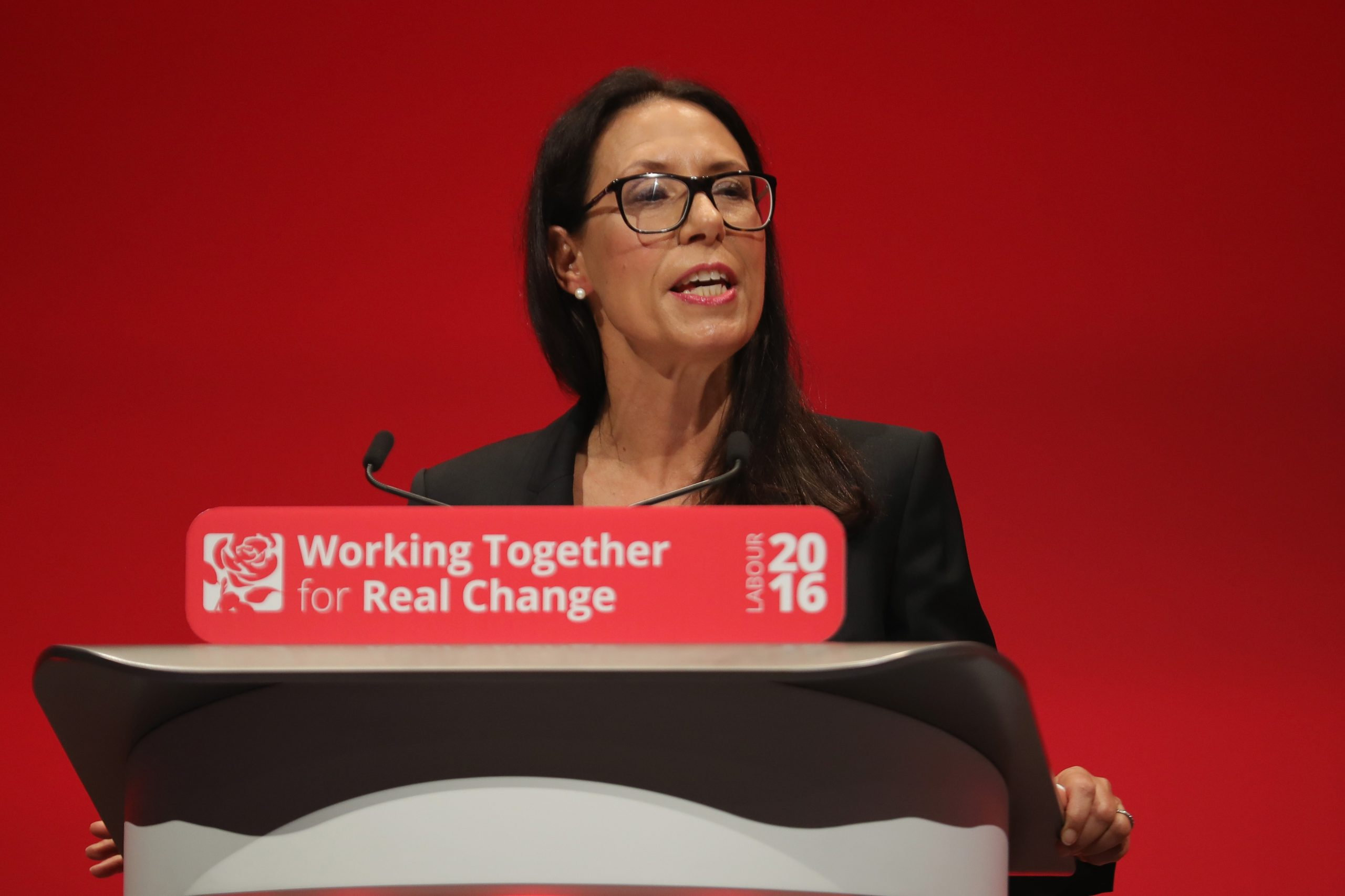 LIVERPOOL, ENGLAND - SEPTEMBER 26:  Debbie Abrahams. Shadow secretary of work and pensions, addresses delegates on the second day of the annual Labour party conference at the ACC on September 26, 2016 in Liverpool, England. Shadow Chancellor John McDonnell has stated that if in power a Labour government would create a 'manufacturing renaissance'. Labour would also support traditional manufacturing and industry with government 'intervention' if needed. Mr McDonnell has also rejected claims that the party is anti-enterprise.  (Photo by Christopher Furlong/Getty Images)