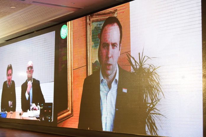 Health Secretary Matt Hancock delivers addresses conference via video message. Steve Brine (L) and Simon Dukes join conference via live video link from London (Photos: Graphic Photo).