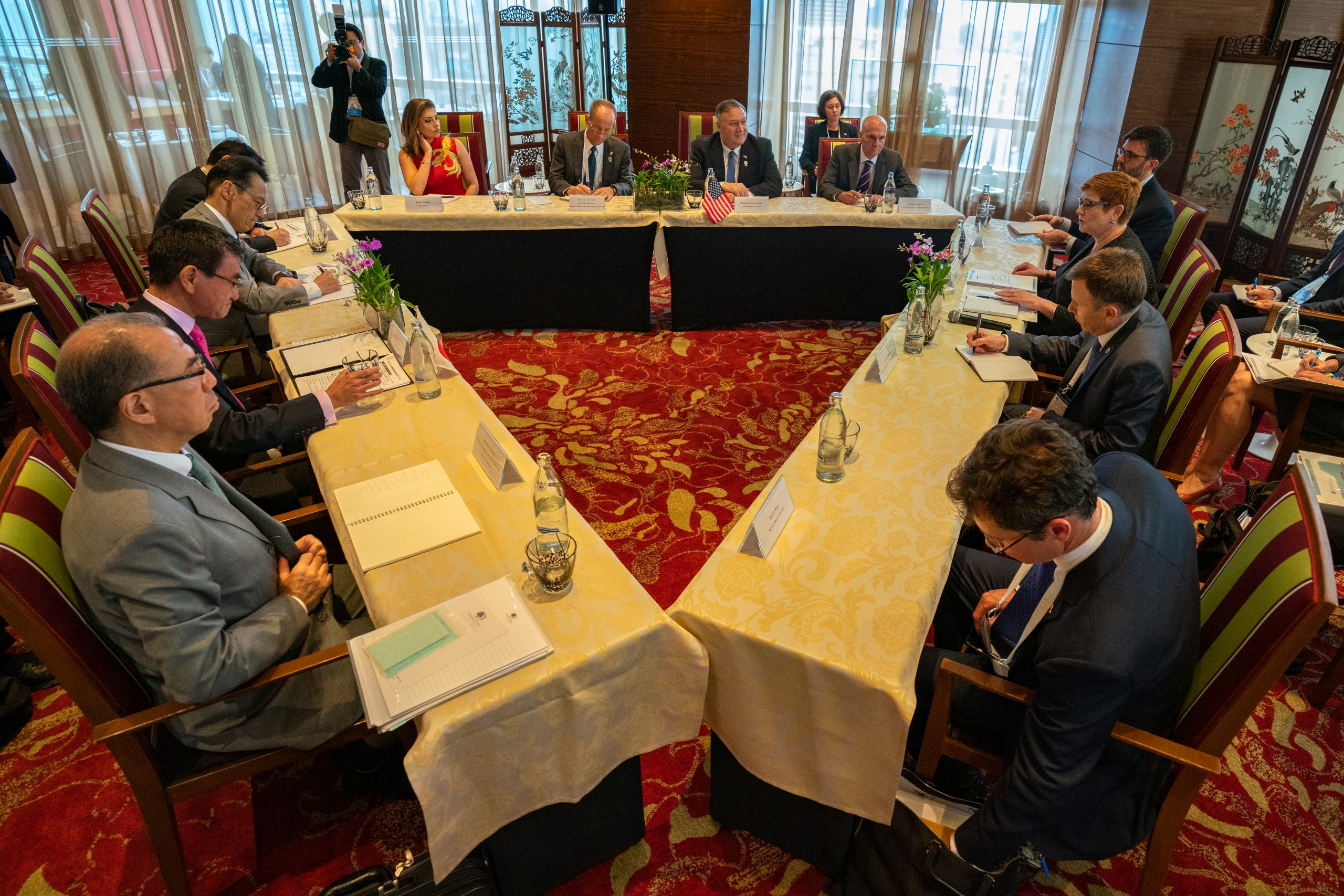FILE PHOTO: Representatives from Japan (left), the United States (center), and Australia (right) participate in Quadrilateral Security Dialogue meeting in  Bangkok, Thailand in August 2019 (State Department photo by Ron Przysucha)