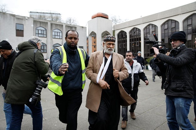 Muazzin Rafat, (R), who was stabbed whilst praying in the mosque the previous day, arrives for Friday Prayers at London Central Mosque near Regent's Park in London on February 21, 2020 (Photo: TOLGA AKMEN/AFP via Getty Images).