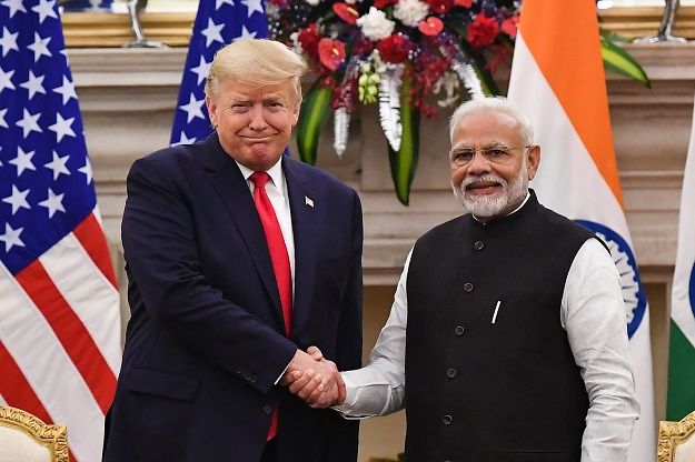 India's prime minister Narendra Modi (R) shakes hands with US president Donald Trump before a meeting at Hyderabad House in New Delhi on February 25, 2020 (Photo: MANDEL NGAN/AFP via Getty Images).