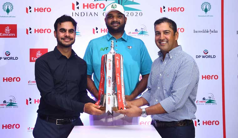 (From L to R) Golfers Shubhankar Sharma, Udayan Mane and Shiv Kapur with Hero Indian Open trophy