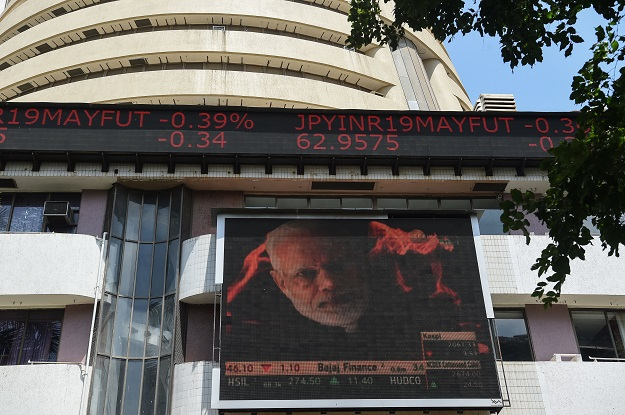 The NSE Nifty 50 index closed down 4.90 per cent at 10,451.45, its worst daily decline since August 2015. The benchmark S&P BSE Sensex ended 5.17 per cent lower at 35,634.95 (Photo of BSE building by PUNIT PARANJPE/AFP via Getty Images).