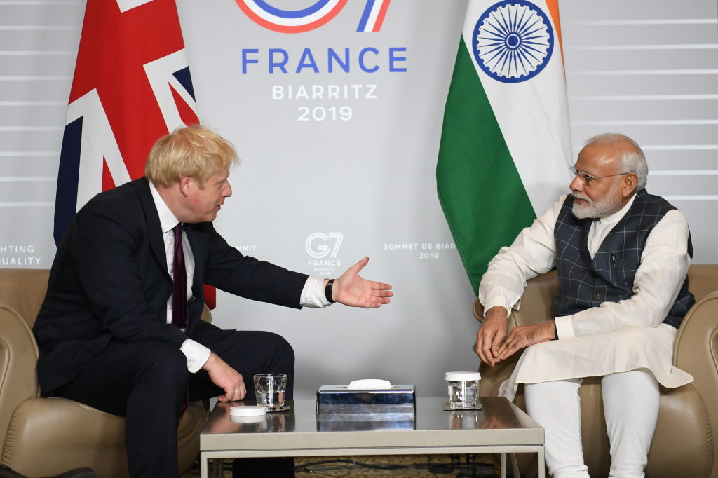 FILE PHOTO: British Prime Minister Boris Johnson (L) meets Prime Minister of India Narendra Modi for bilateral talks during the G7 summit on August 25, 2019 in Biarritz, France. (Photo by Stefan Rousseau - Pool/Getty Images)
