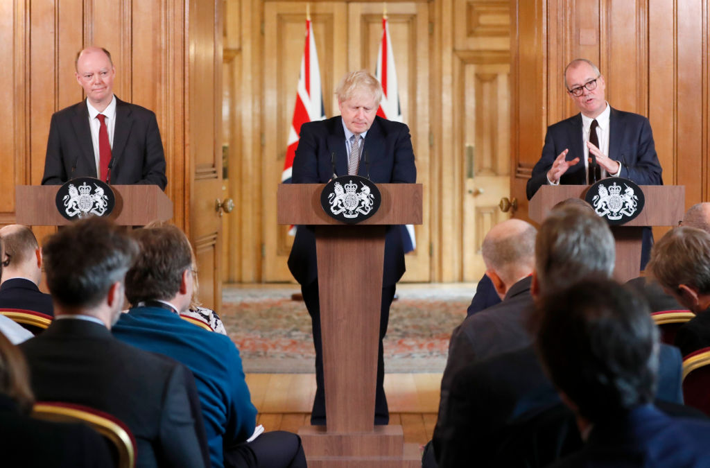 Britain's Prime Minister Boris Johnson (C) flanked by Chief Medical Adviser to the UK Government Chris Whitty (L) and the Chief Scientific Adviser to the UK Government Patrick Vallance (R) gives a press conference at 10 Downing Street in London on March 3, 2020. (Photo by FRANK AUGSTEIN/POOL/AFP via Getty Images)