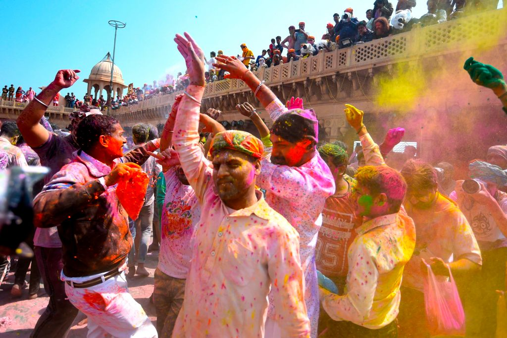 Hindu devotees celebrate Holi, the spring festival of colours, during a traditional gathering at a temple in Nandgaon village in Uttar Pradesh state on March 5, 2020.  SHARMA/AFP via Getty Images)