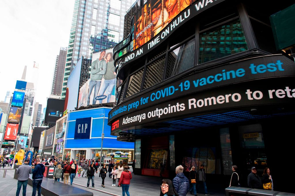 Information related to coronavirus is displayed on a screen in Times Square on March 8, 2020 in New York City. - The governor of New York on March 7, 2020 announced a state of emergency. (Photo by KENA BETANCUR/AFP via Getty Images)