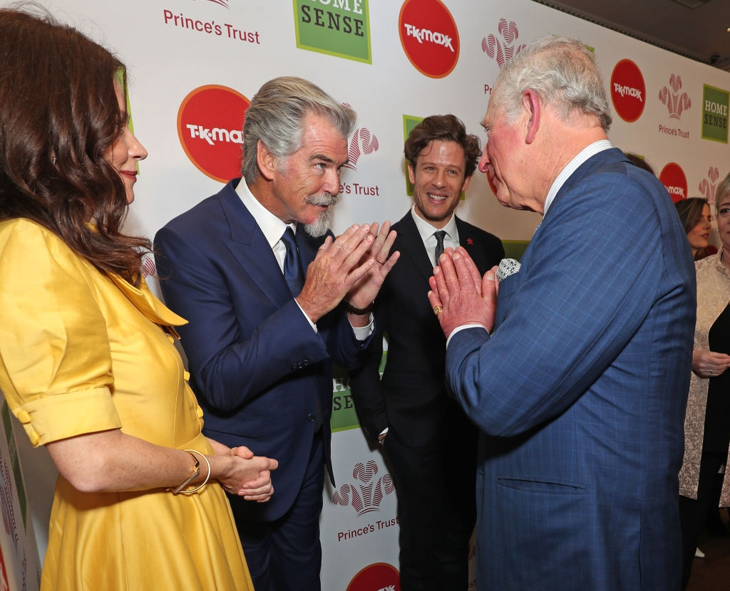 Prince Charles uses the namaste gesture to greet Anna Friel and Pierce Brosnan at the recent Prince's Trust and TK Maxx & Homesense Awards at London Palladium. (Photo: Yui Mok/Getty Images)