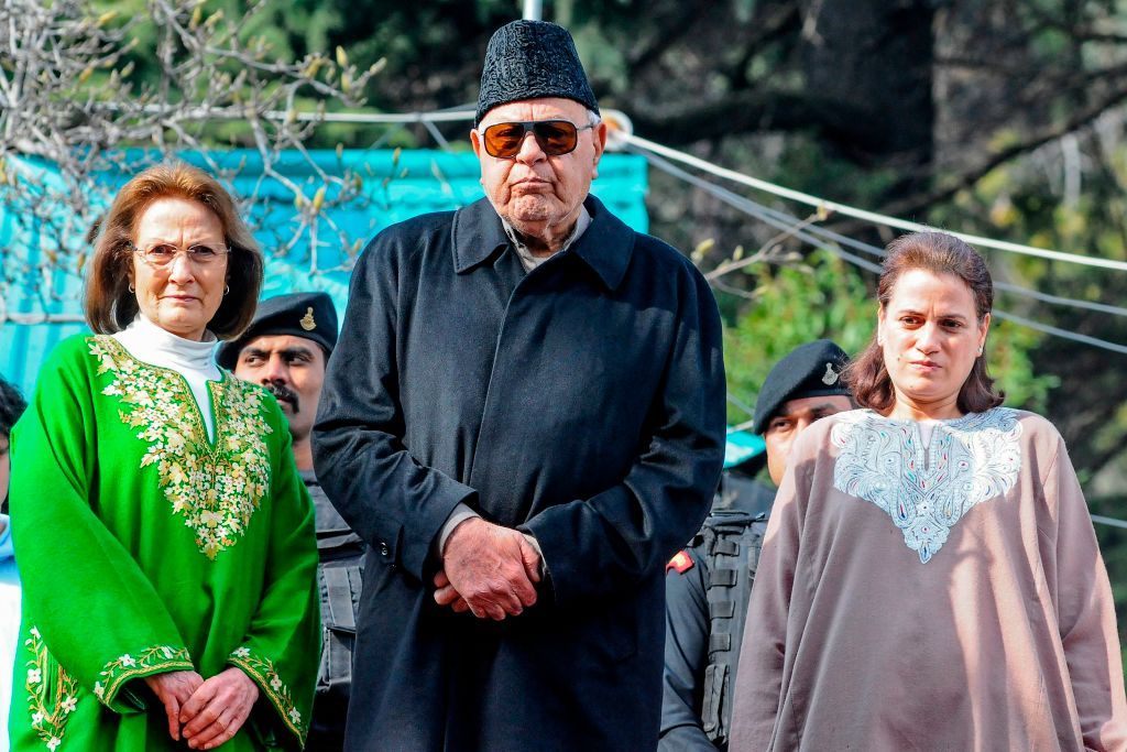 Former Jammu and Kashmir chief minister Farooq Abdullah (C), his wife Molly Abdullah (L) and his daughter Safia Abdullah pose for photographs in front of media representatives at his residence, after his release, in Srianagar on March 13, 2020. -  (Photo by HABIB NAQASH/AFP via Getty Images)