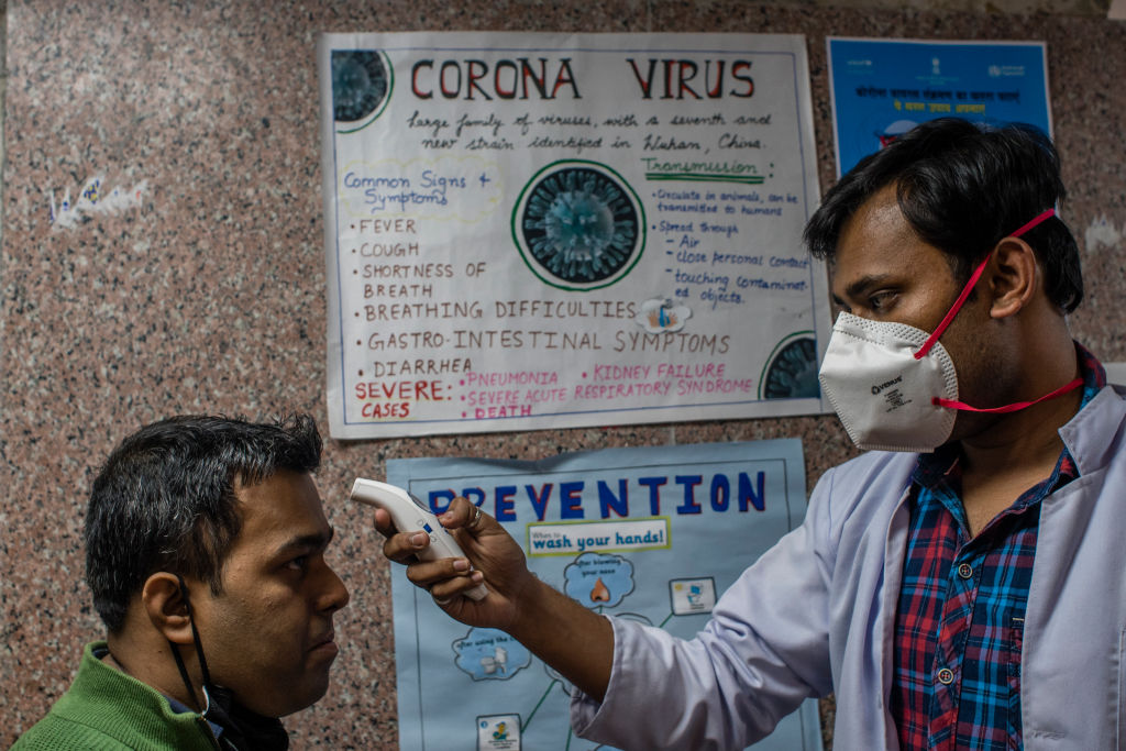 A doctor examines a patient in an area set aside for possible coronavirus cases during a free screening camp at a government homeopathic hospital on March 16, 2020 in New Delhi, India. Tawar Nazir/Getty Images)