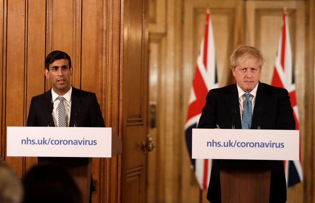 Britain's Chancellor Rishi Sunak, (L) and British Prime Minister Boris Johnson give a press conference about the ongoing situation with the coronavirus (COVID-19) outbreak inside 10 Downing Street on March 17, 2020. (Photo by Matt Dunham - WPA Pool/Getty Images)