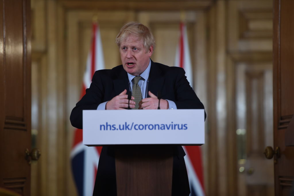 British prime minister Boris Johnson gestures as he gives a press conference about the ongoing situation with the coronavirus (COVID-19) outbreak inside 10 Downing Street on March 18, 2020 in London, England. (Photo by Eddie Mulholland - WPA Pool/Getty Images)