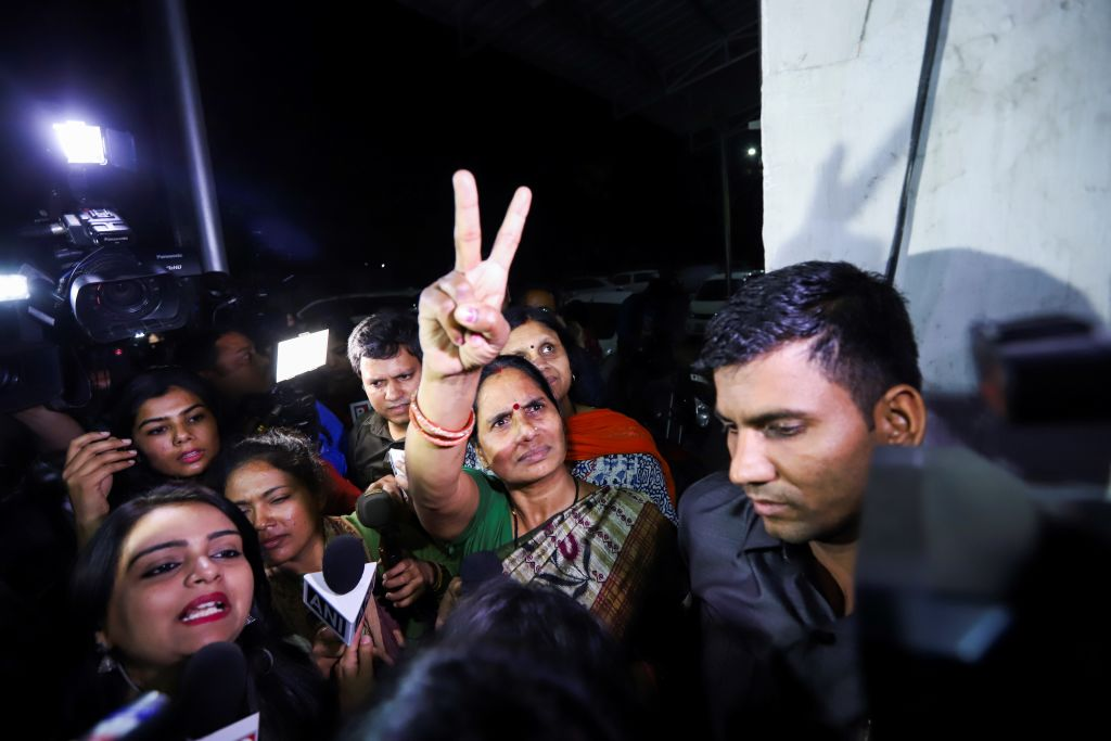 Asha Devi (centre), mother of the Nirbhaya, reacts after the convicts who had brutally raped and murdered her daughter' were hanged in New Delhi on March 20, 2020. (Photo: STR/AFP via Getty Images)