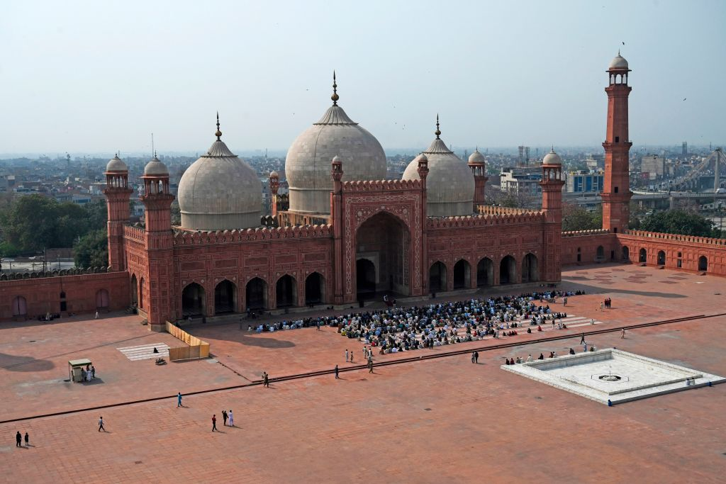 Muslims prepare to offer Friday prayers at partially empty historical Badshahi mosque amid concerns over the spread of the COVID-19 novel coronavirus, in Lahore. (Photo by ARIF ALI/AFP via Getty Images)