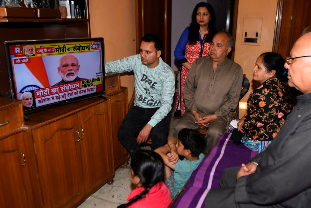 A familywatches Indian Prime Minister Narendra Modi's address to the nation on a television set on a television at their home in Amritsar on March 24, 2020. (Photo by NARINDER NANU/AFP via Getty Images)