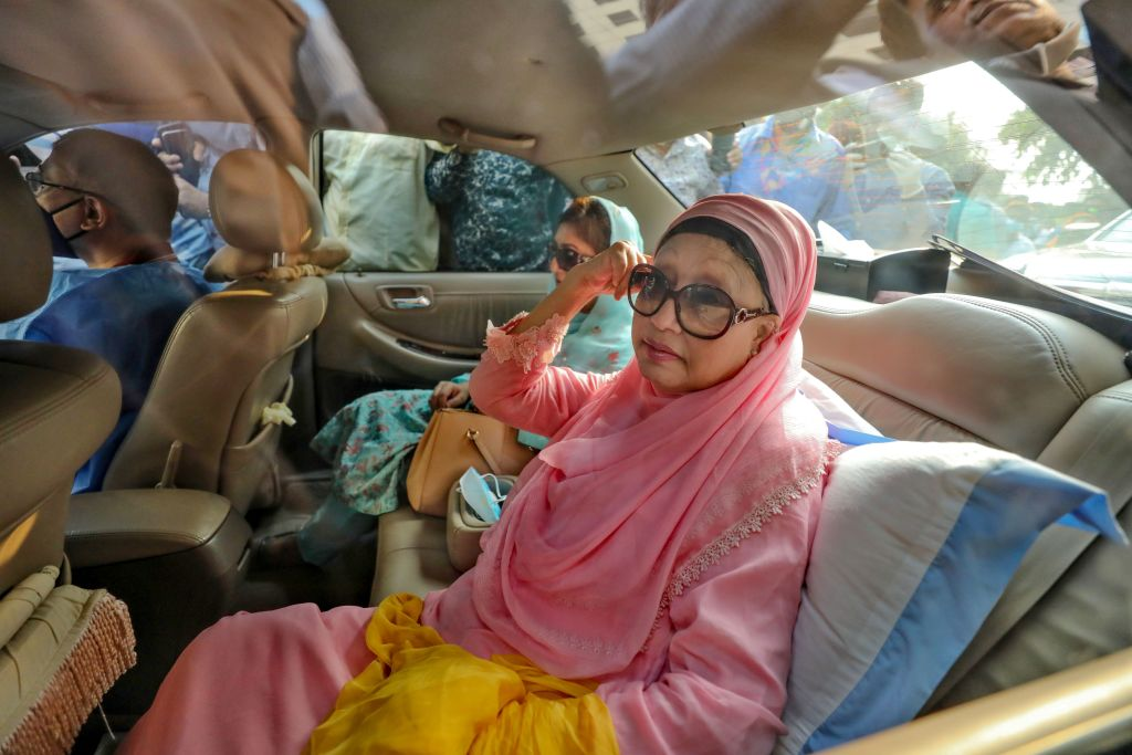 Bangladesh opposition leader Khaleda Zia (R) sits in a car after being released, for medical reasons, from prison where she spent more than two years due to corruption, in Dhaka on March 25, 2020. (Photo by RUBEL RASHID/AFP via Getty Images)