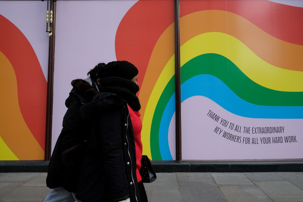 A couple walks past an upbeat thank you message to the NHS in the the shop windows of Harrods store in central London on March 31, 2020, as life in Britain continues during the nationwide lockdown to combat the novel coronavirus COVID-19 pandemic. Photo by ISABEL INFANTES/AFP via Getty Images)