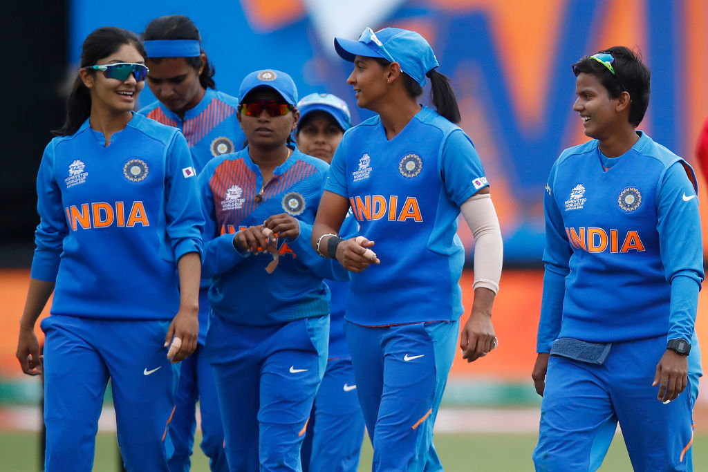 India players celebrate after winning the ICC Women's T20 Cricket World Cup match between India and New Zealand. (Photo by Daniel Pockett/Getty Images)