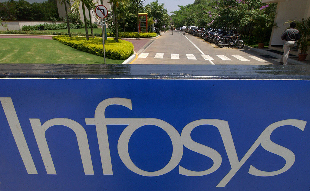 FILE PHOTO: Employees walk inside the campus of Indian software giant  Infosys Technologies Ltd. headquarters in Bangalore. (INDRANIL MUKHERJEE/AFP via Getty Images)