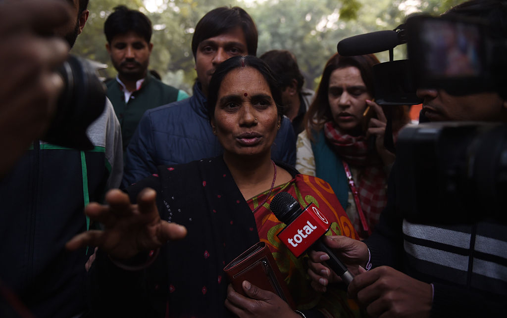 FILE PHOTO: The mother of Indian gangrape victim 'Nirbhaya' (C) talks to the media as she attends a rally held to protest the release of a juvenile rapist, in New Delhi (MONEY SHARMA/AFP via Getty Images)